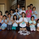 Kelly Fong in Malaysia led her students through a Kids' Yoga Day class